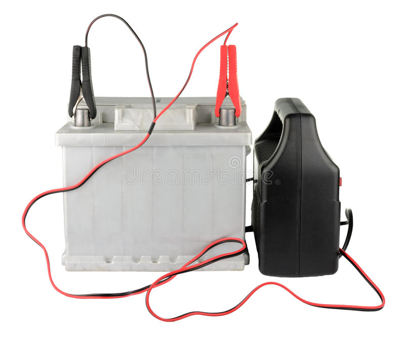 Car battery with two jumper cables clipped to the terminals isolated on white stock photo
