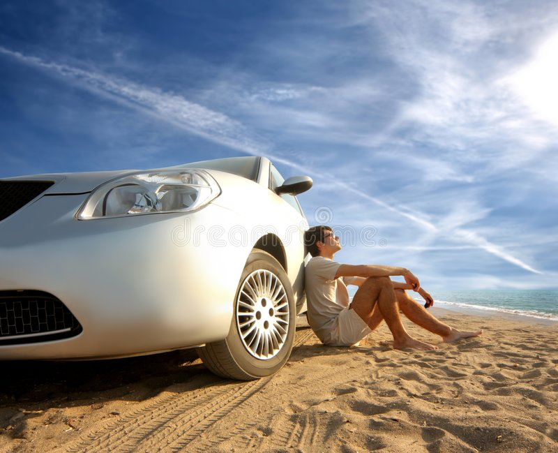 Car on the beach royalty free stock photos
