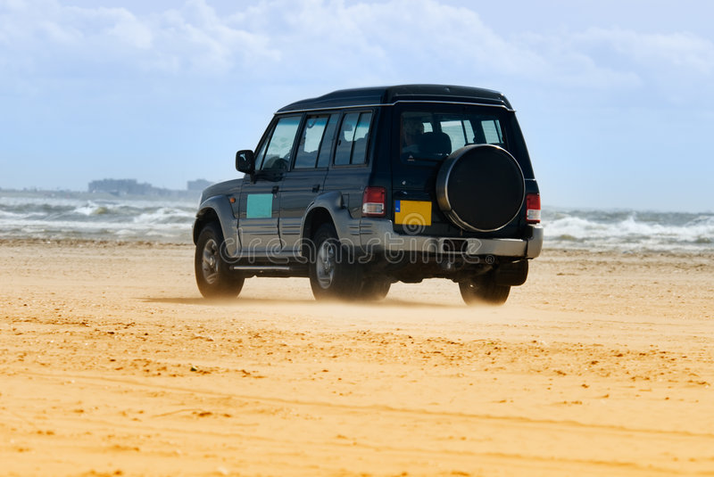 Car on the beach royalty free stock images