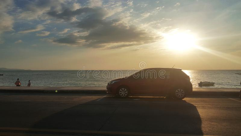 Car on a beach at beautiful sunset, Travel and vacation concept, Summer time concept royalty free stock photos