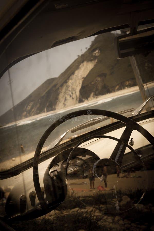 Car on the beach, vintage stock photo