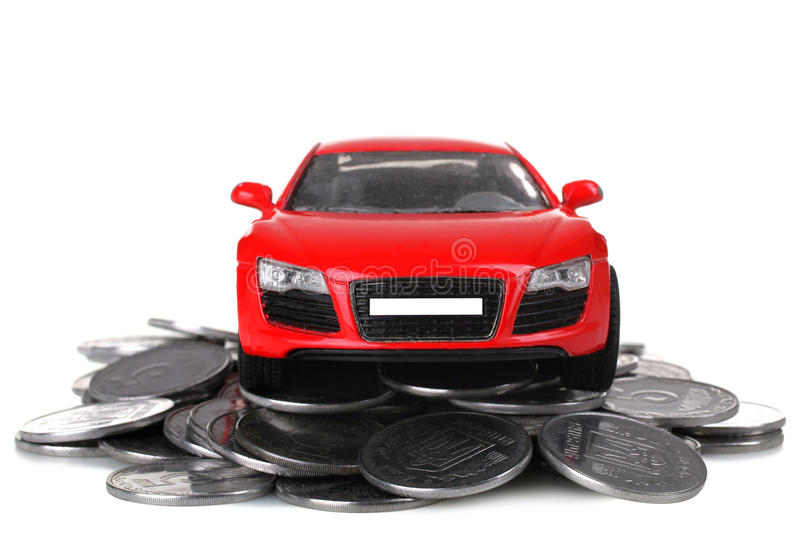Car. Beautiful toy machine is on a pile of silver coins isolated on white background stock photo