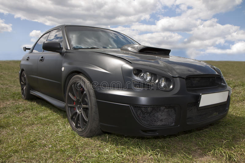 Car of black color on grass stock photos