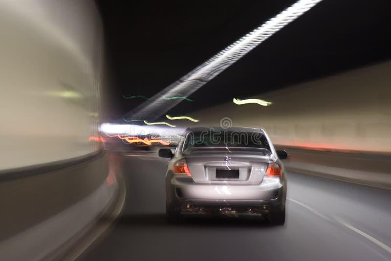 Car Blur tunnel. Sedan car moves via dark tunnel movement blur speed illumination lines stock image