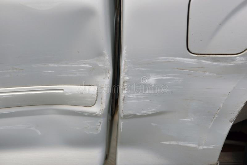 Car body side damage after an road traffic accident, close- up royalty free stock photography