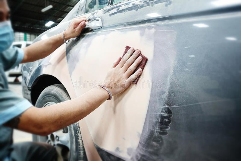 Car body work auto repair paint after the accident during the spraying royalty free stock image