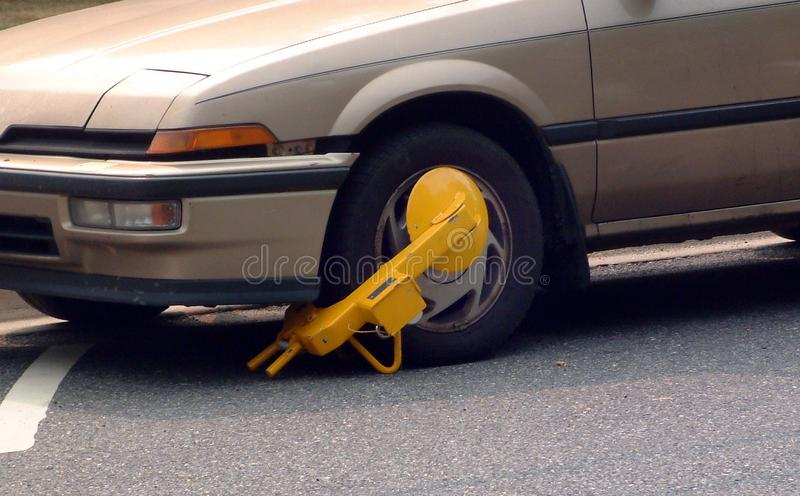 Car booted with a parking boot stock images