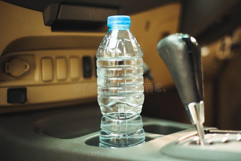 In the car is a bottle of water, for the driver royalty free stock photo