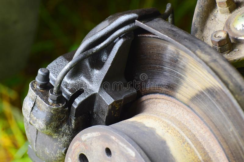 Car brake disc with brake caliper. When the wheel is removed royalty free stock photo