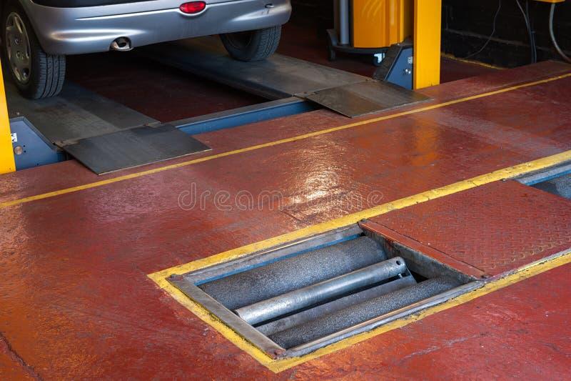 Car brake inspection. Car brake checking roller machine royalty free stock photos