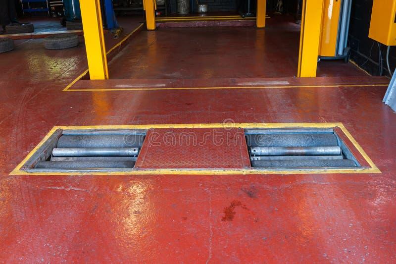 Car brake inspection. Car brake checking roller machine royalty free stock photography