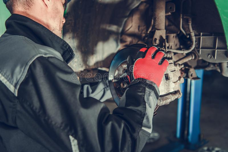 Car Brakes Maintenance. Automotive Industry. Car Brakes Maintenance Performed by Caucasian Auto Service Mechanic stock image