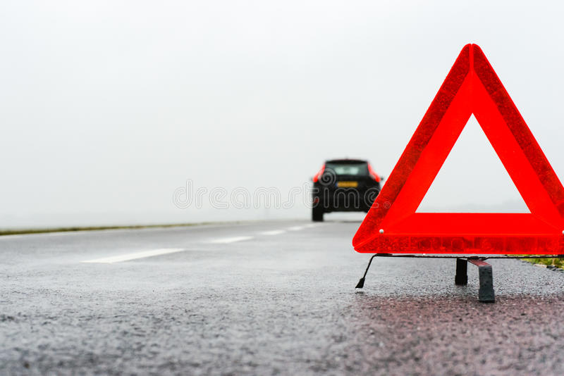 Car with a breakdown in the rain and fog stock photos