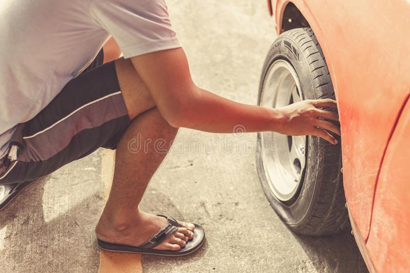 A car breakdown and wheel flat tire in the park. stock photos