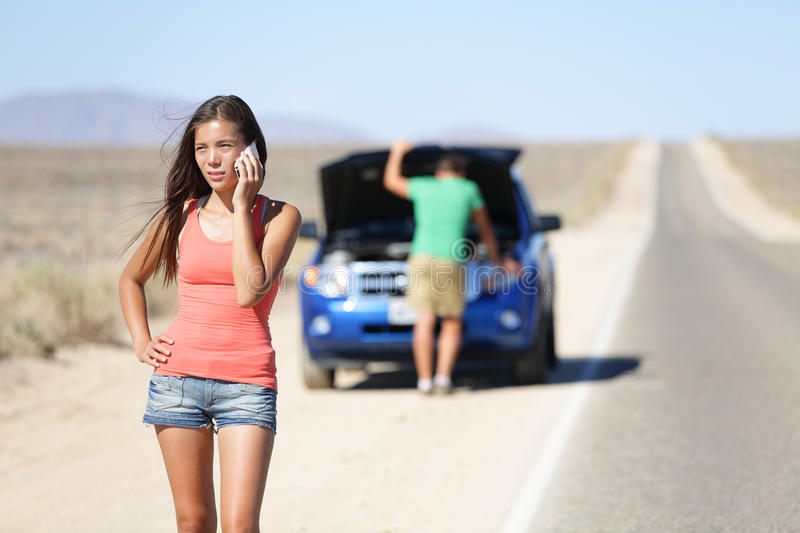 Car breakdown - woman calling auto service help. Car breakdown - women phone calling auto service help. Neutral or negative expression on women on mobile smart royalty free stock photo
