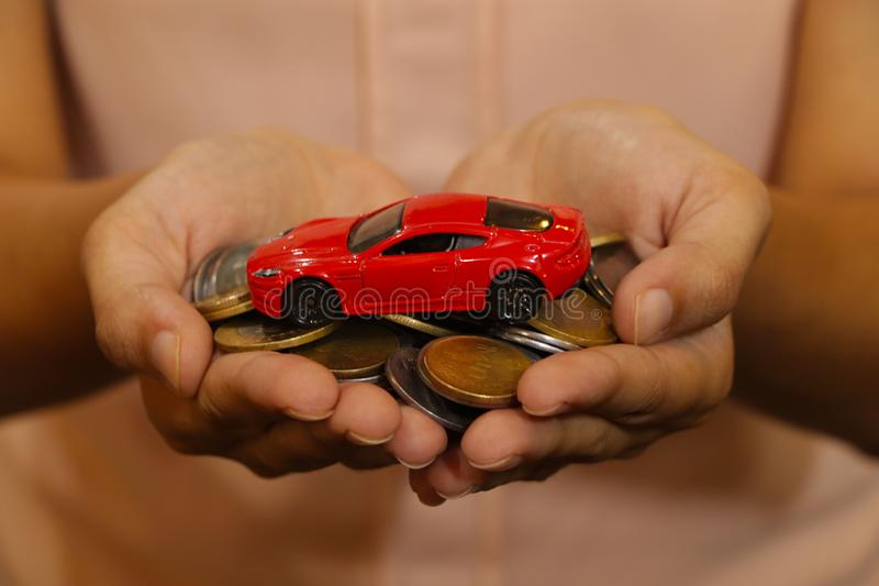 Car. A bunch of Indian Currency Coins in Hand with car model. A bunch of Indian Currency Coins in Hand  with car model. Money and car concept stock photos