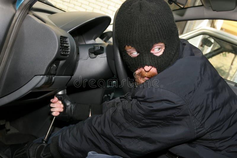 Car burglary. Burglar wearing a mask (balaclava), details car burglary inside royalty free stock photography