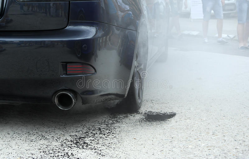 Car burnout with smoke stock images