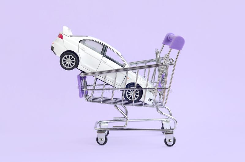 Car buying and leasing concept. Vehicle in shopping cart stock photos