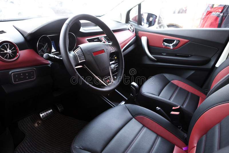 Car cab interior. The sports car cab interior with soft leather seat and steering wheel stock photo