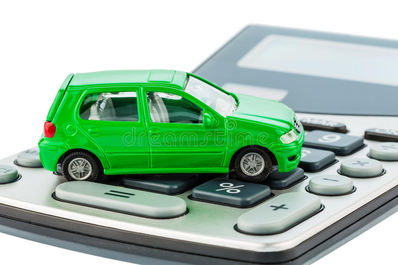 Car and calculator. A car is on a calculator. cost of gasoline, wear and insurance. car costs are not paid by commuter tax royalty free stock images