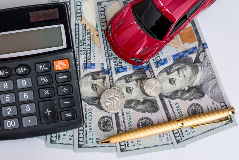 Car and calculator, money, pen. Toy car and calculator, money, pen royalty free stock images