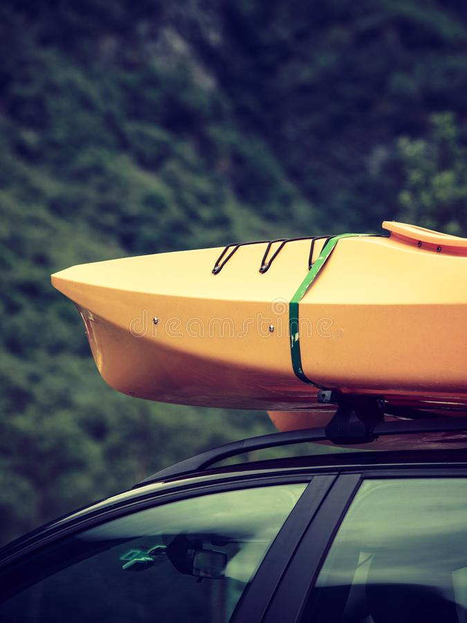 Car with canoes on top. Active lifestyle sport concept. Car with kayak yellow canoe on top roof ready to transportation royalty free stock images