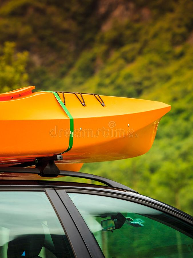 Car with canoes on top. Active lifestyle sport concept. Car with kayak yellow canoe on top roof ready to transportation royalty free stock photos