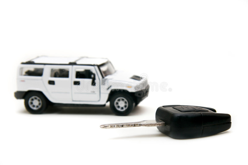 Car and car key over white. Focus on key stock images