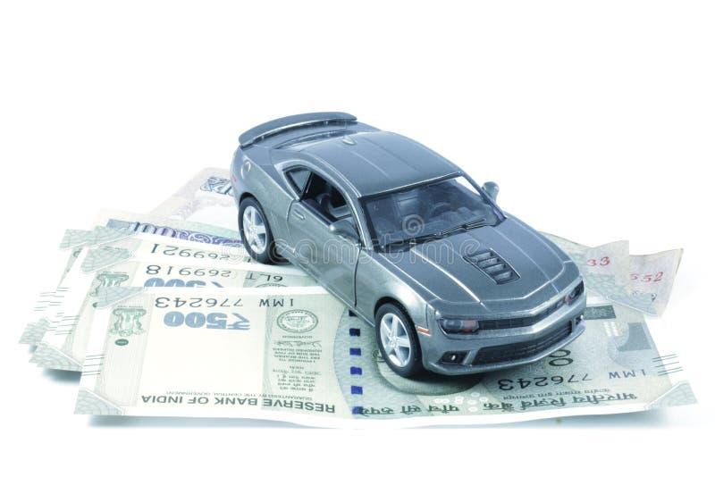 Car, Car Loan, Car Insurance, Car Expenses, Car Hire. An image depicting car loan or car insurance cover or Car related expenses. Car with coins. Car with Money stock photography