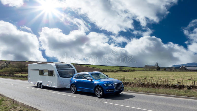 Car and Caravan on the road stock photography