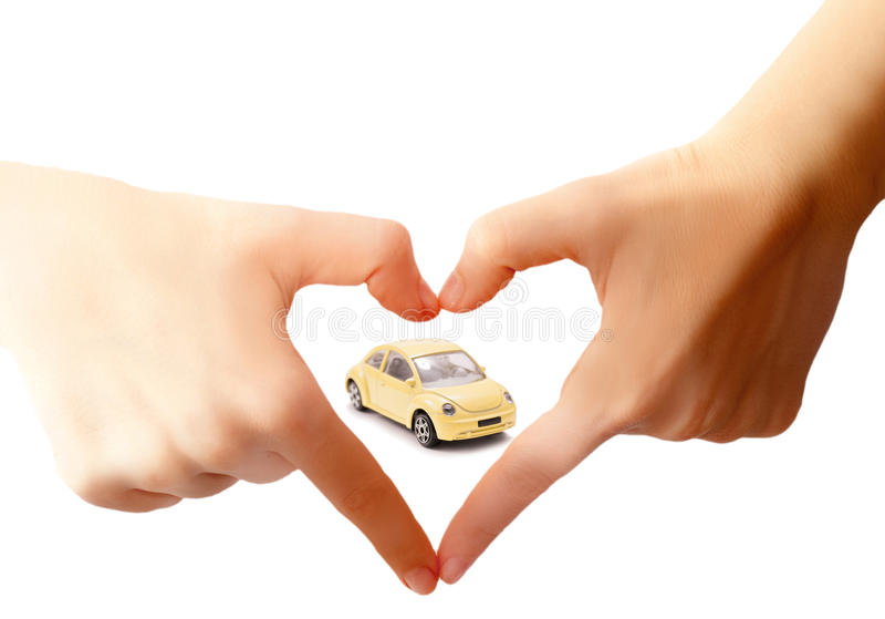 Car care concept. With a yellow toy and love hands sign royalty free stock images
