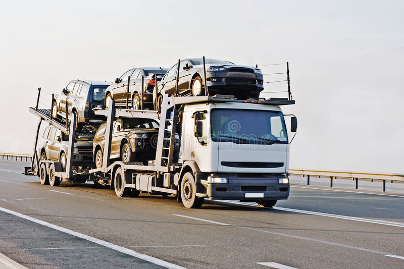 Car carrier truck deliver new auto batch to dealer royalty free stock photos