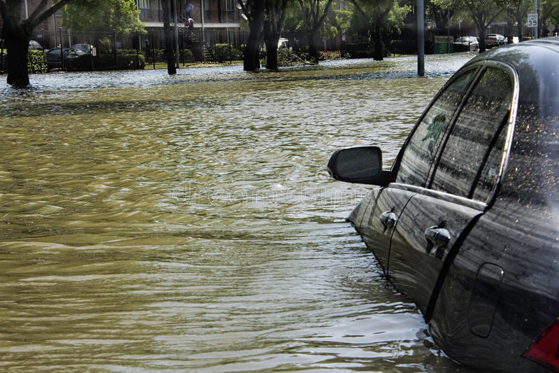 Car Caught in Flood Waters. Brays Bayou overflowed during recent Houston, Texas floods. Many auto drivers were caught by surprise and forced to abandon vehicles stock photo