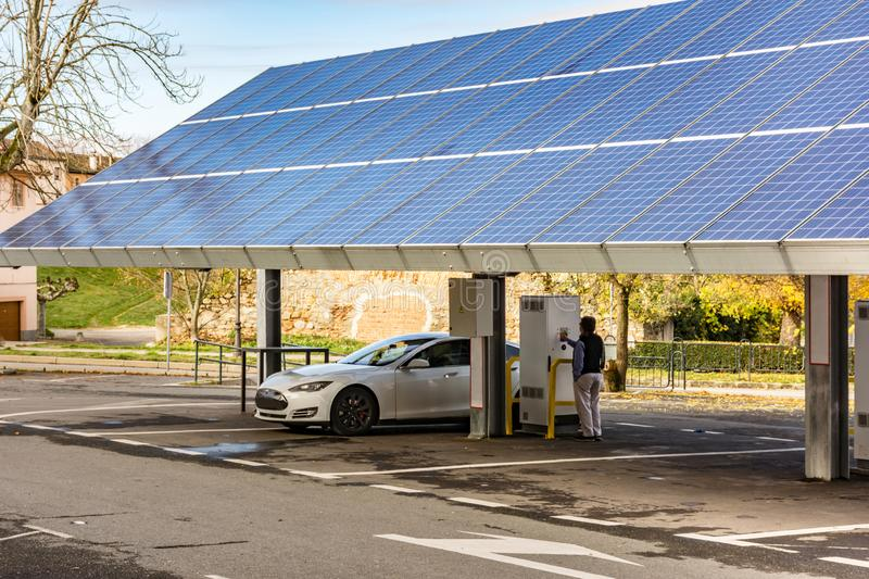 Car charging station for self-sufficient and first photovoltaic panels in Europe. it is also free.  stock image
