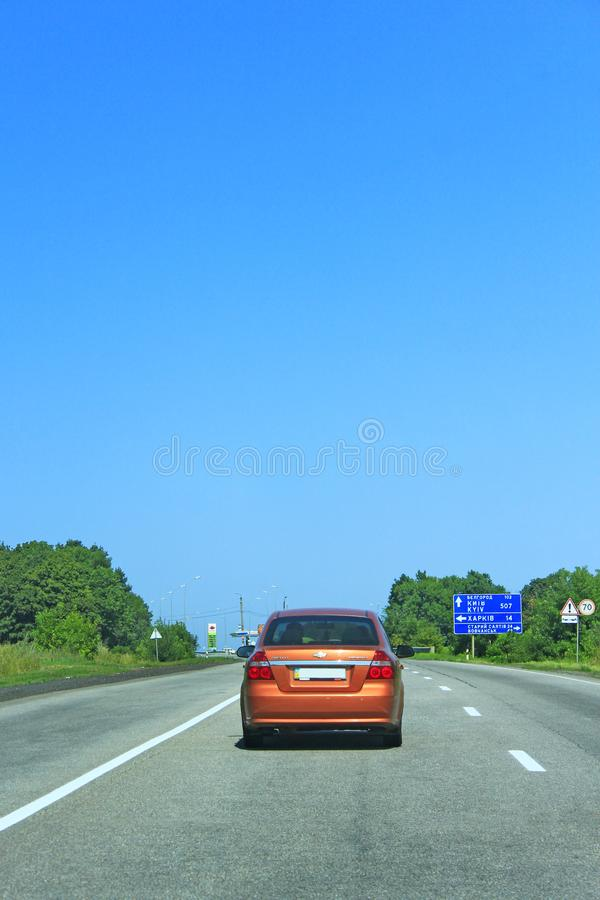 Car Chevrolet Aveo LT during movement on asphalted road. Auto concept. Car Chevrolet Aveo LT during movement on asphalted road. Chevrolet Aveo in orange color stock photos