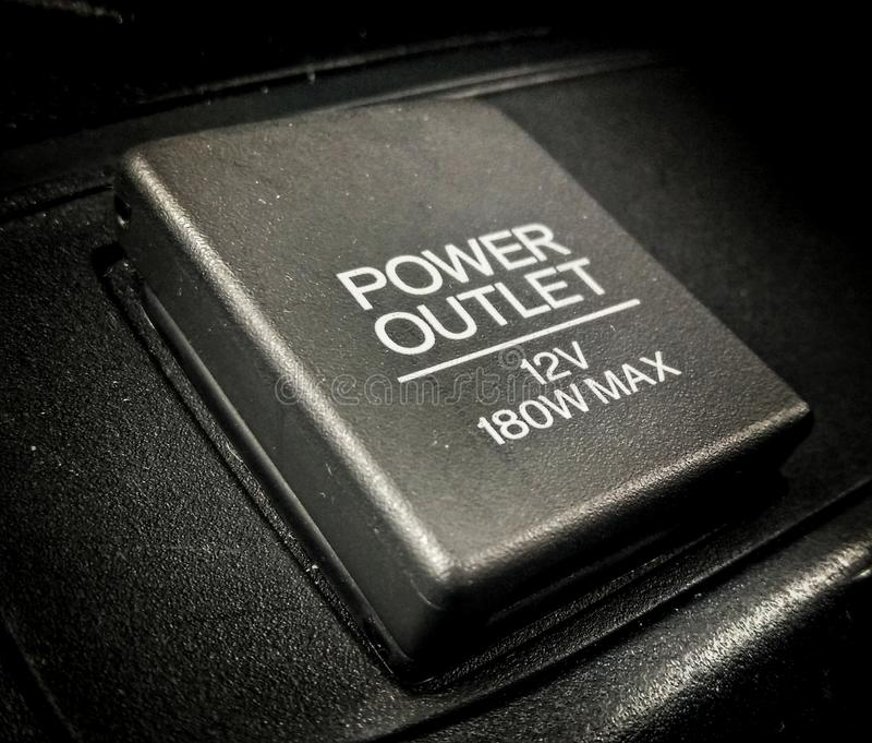 From car cigarette lighter to 12V accessory socket royalty free stock photos