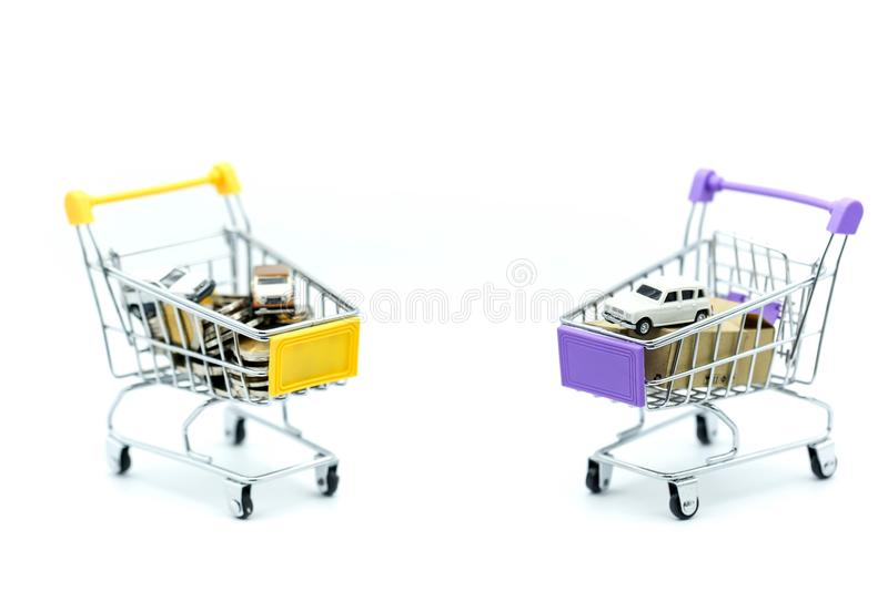 Car and coins in shopping cart,auto loan concept. royalty free stock photos