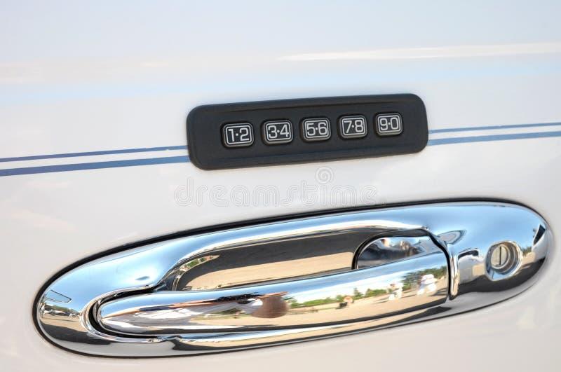 Car combination lock. Over a door handle royalty free stock image