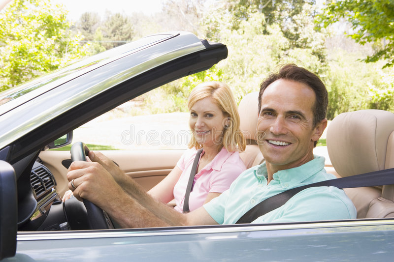 car convertible couple smiling στοκ εικόνα