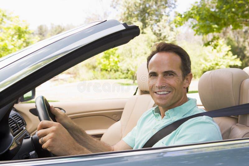 car convertible man smiling στοκ φωτογραφία