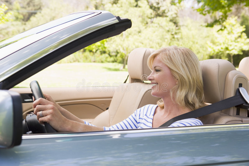 car convertible smiling woman στοκ φωτογραφία