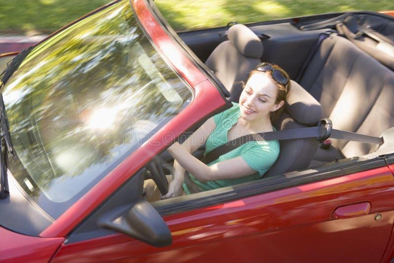 car convertible smiling woman στοκ εικόνα με δικαίωμα ελεύθερης χρήσης