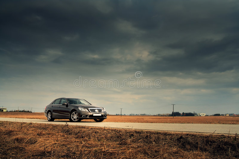 Car on country road royalty free stock photos