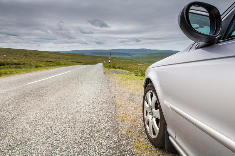 Car by country road. A car and country road fading into the distance over Langdon Common in the North Pennines royalty free stock photos