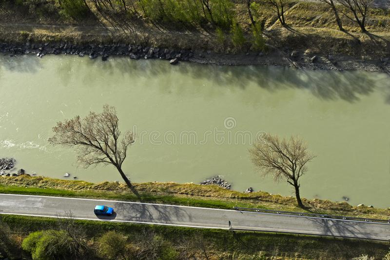 Car on a country road by a river stock image