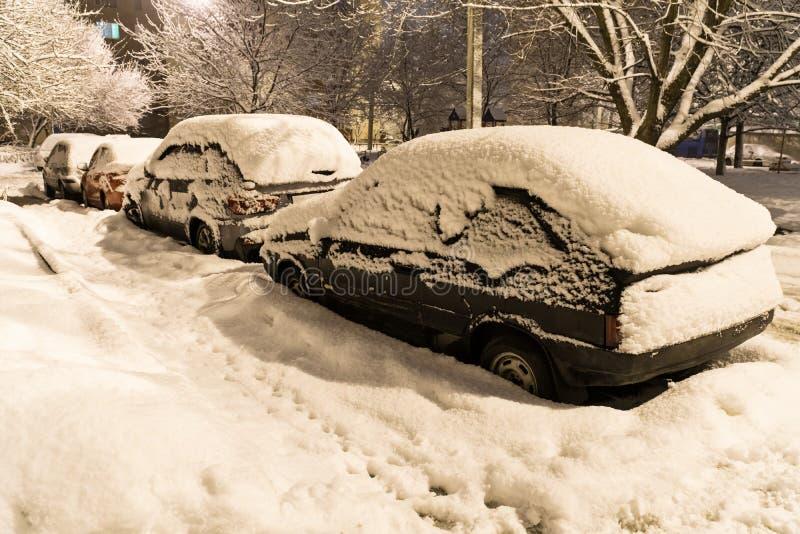 Car covered fresh white snow stock photos