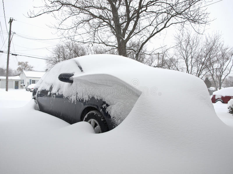 Car covered in snow royalty free stock photo