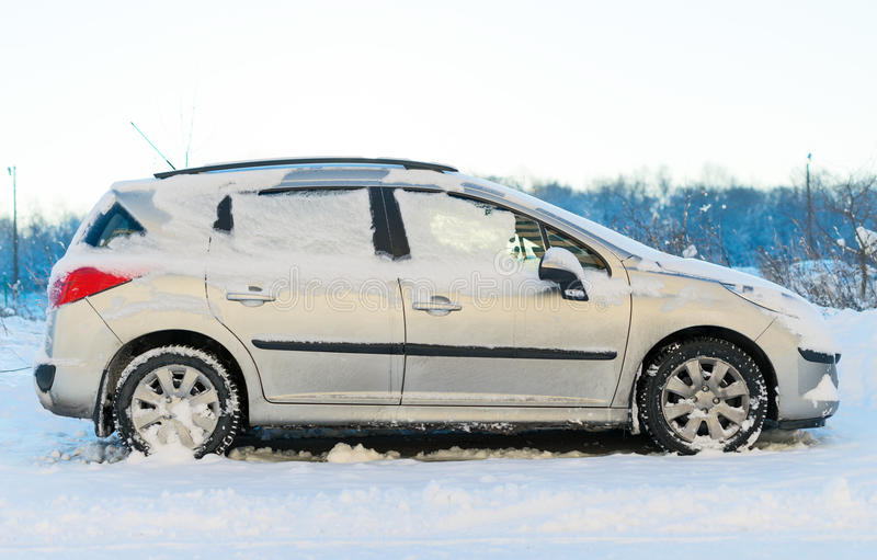 Car. Car covered with snow in the winter stock images