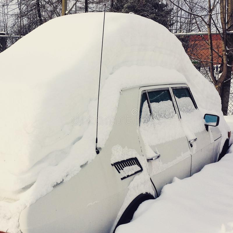Car cowered by snow stock image